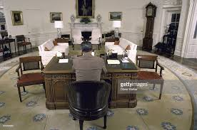 oval office white house. A Wideangle View Of President Ronald Reagan Sitting At His Desk In The Oval Office White House E