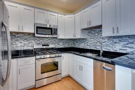 kitchen cabinets with granite countertops: picture of luxury shaker white kitchen cabinets feat black granite countertop