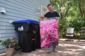 trash cans default: horizon west resident creates solution to camouflage trash cans
