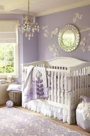 paint bedroom photos baadb w h: the dangling crystal chandelier and round mirror with a weathered finish add sparkle to the room to make this nursery extra special