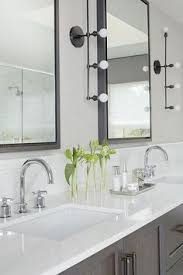 washstand bathroom pine: chic bathroom features a gray wash double washstand topped with gleaming white quartz fitted with his