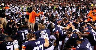 Image result for picture of auburn football team praying