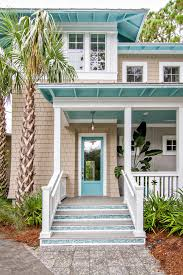 front doors example of a coastal living room design in new york with white walls light beach house decor ideas beautiful beach homes ideas