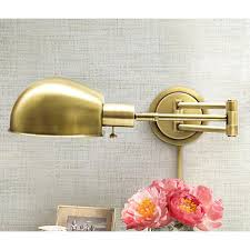 house of troy addison antique brass swing arm wall lamp brass swing arm wall