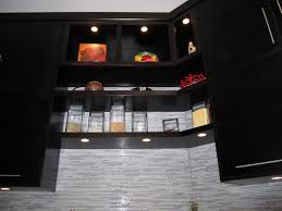recessed led puck lights also used for the alcoves above the open shelving modern cabinet lighting puck light