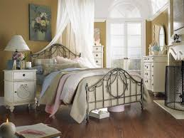 simple designed side table painted in white placed near with metal master bed in traditional bedroom using victorian bedroom decorating ideas and hardwood bedroom luxurious victorian decorating ideas