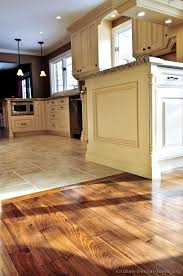 kitchen floor tiles small space: kitchen idea of the day perfectly smooth transition from hardwood flooring to tile floors