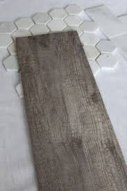subway tiles tile site largest selection: the bathroom floor will wear this tile it looks like a weathered wood floor