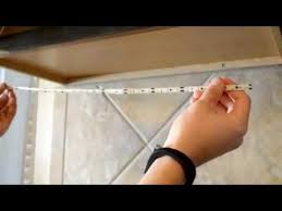 how to install led under cabinet lighting youtube adding cabinet lighting
