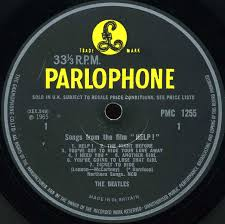 the beatles collection help parlophone pmc  variation b other of the original labels used a thick font and the same credit indicator for i need you was placed to the right of the song title