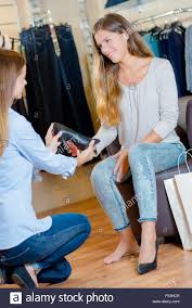 female s assistant working as florist and holding bouquet s assistant in a shoe shop stock photo royalty image s assistant jobs nyc assistant