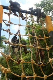 u s department of defense photo essay nian special operations team members climb a rope ladder during an obstacle course event as part