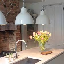 love love love these industrial light fittings in this modern country kitchen why not head on over to join our free interior design resource library at amish country kitchen light