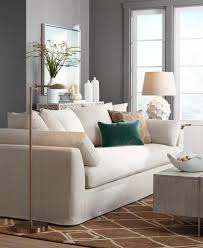 a living room seating area with an led floor lamp add task lighting