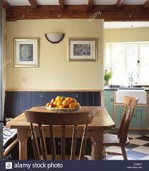 Cottage Dining Room Table Bowl Of Fruit On Pine Table With Pine Chairs In Cottage Dining