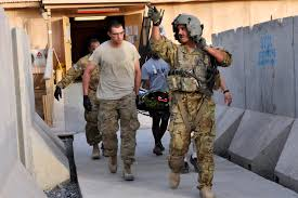 u s department of defense photo essay a u s army crew chief directs u s iers carrying a wounded afghan border policeman to a