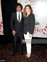 directorwriterproducer m night shyamalan and actress kathryn hahn a picture id487318678 director writer producer m night shyamalan l and actress kathryn hahn