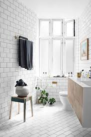 bathroom white tiles: floor to ceiling white tiles using matt on the floor with black grout and gloss on the walls brings a new dimension to a small bathroom whilst giving it a