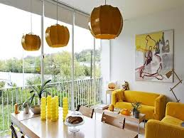 yellow furniture inspiration yellow couch sofa in small living room wood living room table dining wood table abstract yellow painting on white wall orange bright yellow sofa living