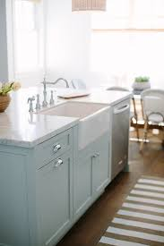 kitchen hardware is chrome with blue island painted in farrow ball light blue and carrara marble worktop blue cabinet kitchen lighting