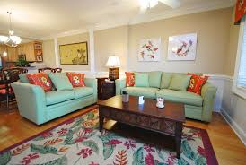 beautiful living room sets furniture design with soft green sofa and red cushion also dark brown beautiful living room furniture