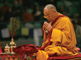 The Dalai Lama in prayer
