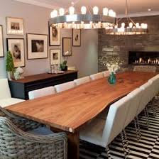 long wood dining table: long natural wood dining table with white and wicker chairs and black white rug
