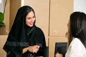 arabian receptionist helping a customer on the front desk stock arabian receptionist helping a customer on the front desk stock photo 32818310