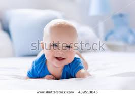 baby boy bedroom images: adorable baby boy in white sunny bedroom newborn child relaxing in bed nursery for