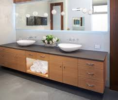 dwell bathroom cabinet: captivating contemporary bathroom  awesome modern bathroom furniture with long wooden vanity unit unify base cabinet and drawers incorporates shelving organizer rectangle black table top also twin porcelain sink including lovely plant