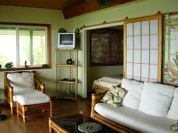 decoration small zen living room design: living room small zen living room design alongside maple wood floor material and bamboos frame platform chair in addition bamboos legs dark glass top