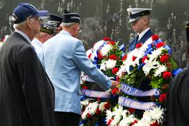 u s department of defense photo essay a korean war veteran lays a wreath to honor the memory of those who died in