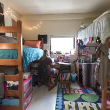 bedroom furniture contractstudentbedroomfurniture:  bed with desk underneath middot student sitting at desk in tower hall