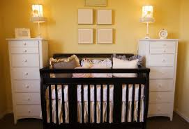 bright yellow baby girl nursery room with double side space white wood cabinet furniture also charming baby furniture design ideas wooden