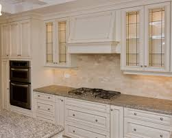 nice lighting inside and under upper kitchen cabinet with glass doors presenting serene light and ambiance ambiance under cabinet lighting