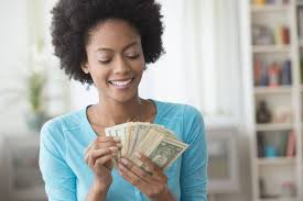 how to ask for a raise hellobeautiful african american w counting money in living room