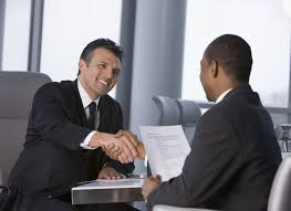 hospitality job resume samples man interviewing another man resume in hand