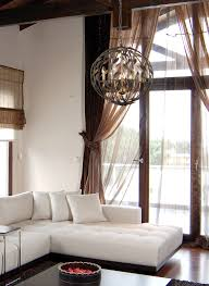 awesome family room design with white sofa matched with white wall with tan curtain plus crystorama awesome family room lighting ideas