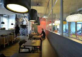 cool hanging lamps in small cafe at new office interior for unilever headquarters by camenzind evalution futuristic workspace interior design cafe interior design office