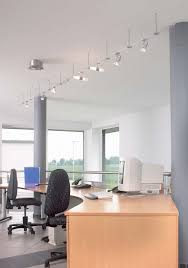 contemporary home office furnished with curved table and simple swivel chair under modern track lighting basement lighting track lighting track