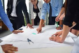 Image result for home builder reviewing plans with young couple