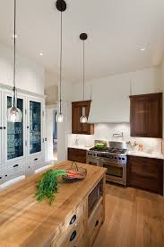 urban homestead inspiration for a timeless enclosed kitchen remodel in other with stainless steel appliances wood breathtaking modern kitchen lighting options