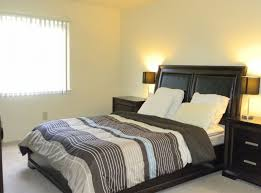 bedroomsoft yellow white master bedroom design with facing bed and black bed frame also charming bedroom feng shui