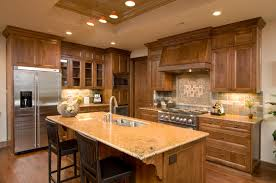 build kitchen island sink: a small kitchen with a beautiful multi colored backsplash and natural wood cabinetry the
