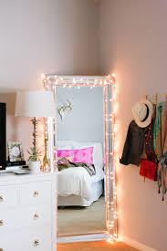 twinkle lights around a full length mirror theeverygirl bedroom accent lighting surrounding