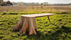 french artist designs stunning table with giant tree stump for leg 1 awesome tree trunk table 1