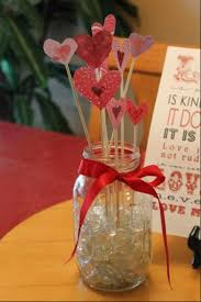 day orchid decor:  make a diy flower vase cut out cardstock hearts and glue them to wooden skewers place them in a mason jar filled with clear rocks