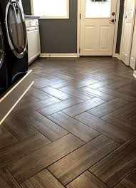 kitchen floor tiles small space: gray color tile herringbone pattern perfect for my back door room that acts as mud room pet space office i would not change anything
