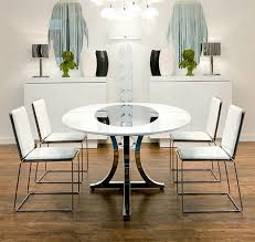 dining room table mirror top: this table is an elegant piece in the dining area especially with the oval mirror on top of it it has pretty penguin shaped mirrors on the wall too