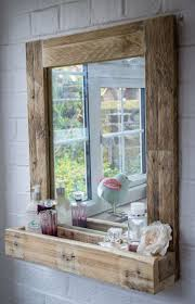country themed reclaimed wood bathroom storage: pallet wood mirror frame with storage